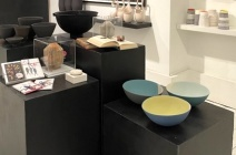 """Plinths: Back left: Tanya McCallin """"Vessels""""; Back right: Forest + Found: Max Bainbridge """"Offering Bowl 1""""; Center left: Cards by Natasha Sorelli, Monica Fierro """"The Secret"""", Valeria Nascimento """"White Porcelain Brooch""""; Center right: Jeremy May """"Gone with the Wind"""" and """"Ulysses"""" by James Joyce, Monica Fierro """"Flowering""""; Front: Maria Wojdat """"Shadow Bowls"""""""